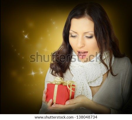 Surprise woman with Christmas gift - stock photo