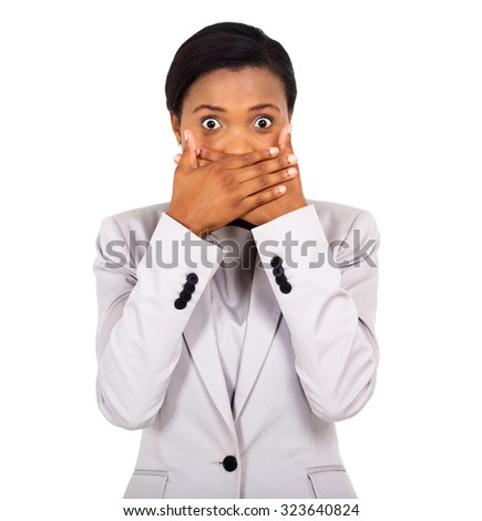surprised african american woman covering her mouth with hands - stock photo