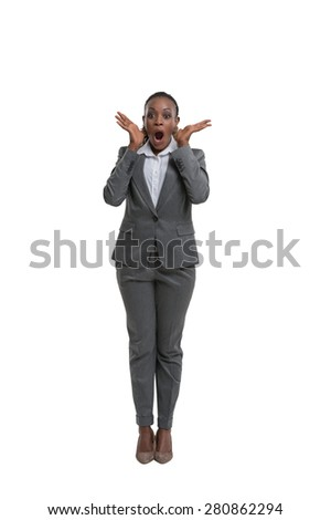 Surprised african business woman portrait isolated on white background - stock photo