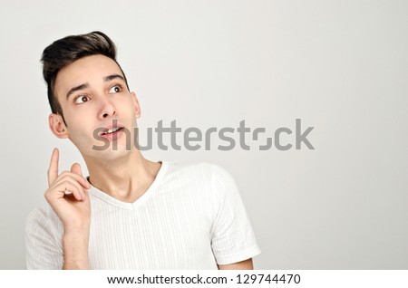 Surprised, amazed, wowed. Young man looking up. Watching a 3 D movie. - stock photo