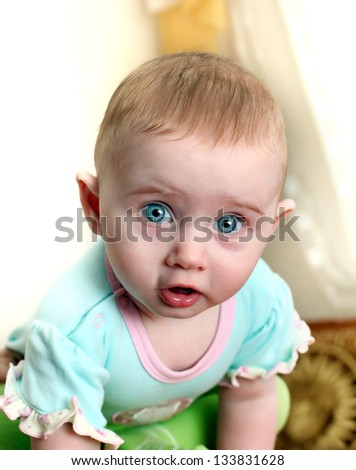 Surprised and Funny Little Baby Portrait at the Home - stock photo