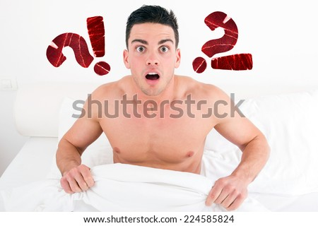surprised and shocked half naked young man in bed  looking down at underwear at penis under white covers sheet in badroom. Concept photo of male sexuality and man sex problems, domestic atmosphere. - stock photo