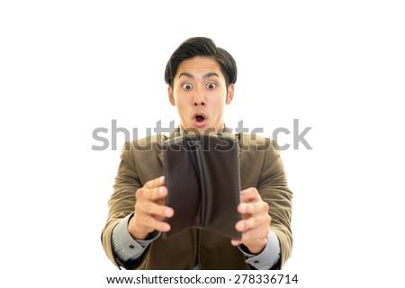 Surprised Asian businessman - stock photo