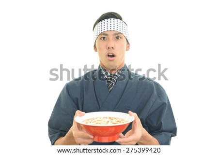 Surprised Asian cook - stock photo