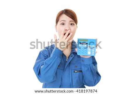 Surprised Asian female worker  - stock photo