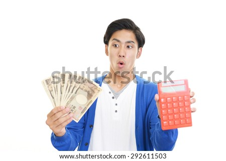 Surprised Asian man with money