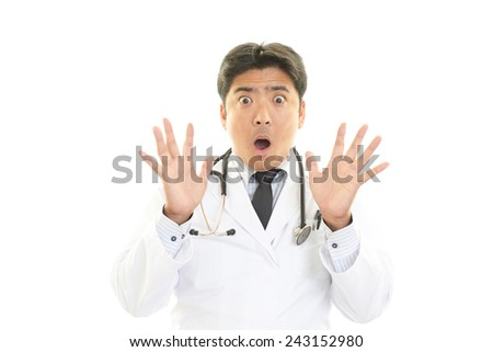 Surprised Asian medical doctor - stock photo