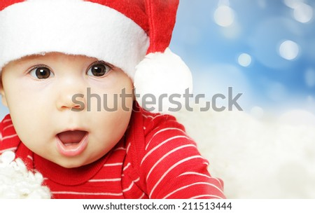 Surprised baby in Santa hat having fun, Christmas and Happy New Year concept - stock photo