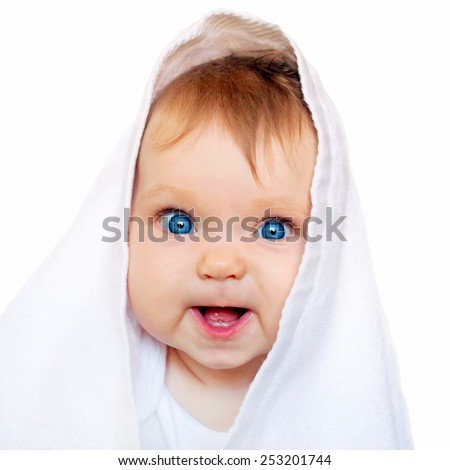 Surprised baby under the white towel after bath. Isolated on white background. - stock photo