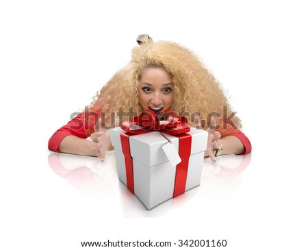 Surprised beautiful young woman looking to gift box isolated on  white background. Holidays, holiday, celebration, christmas, birthday and happiness concept