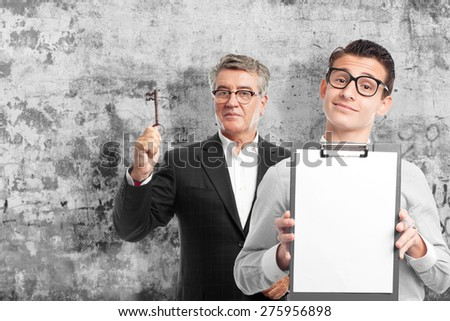 surprised blond man. cement wall background - stock photo