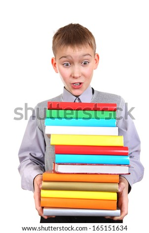 Surprised Boy holding Pile of the Books Isolated on the White Background