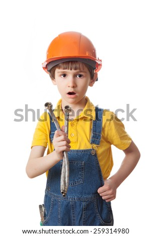 surprised boy in a protective helmet holding a flexible liner - stock photo