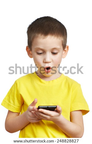 Surprised boy looking at phone isolated