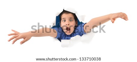 Surprised boy looking through paper hole isolated on white background - stock photo