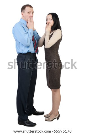 Surprised business couple isolated on white - stock photo