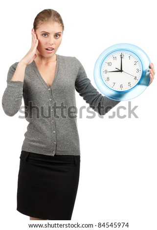 Surprised business woman holding a big clock, over white background