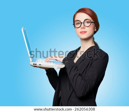 Surprised business women with laptop on blue background. - stock photo