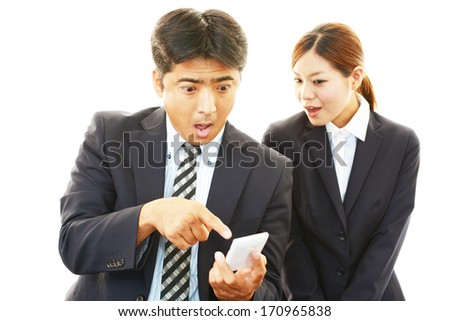 Surprised businessman and businesswoman - stock photo