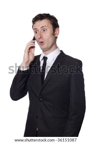 surprised businessman in a black suit with a mobile phone