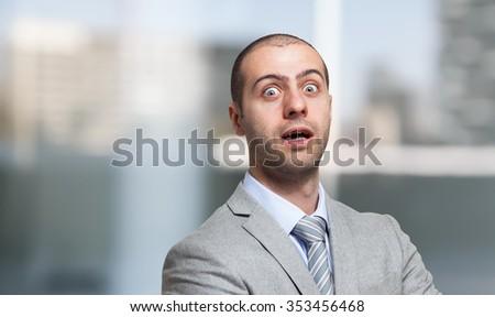 Surprised businessman portrait - stock photo