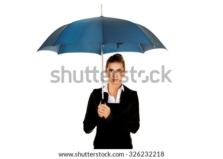 Surprised businesswoman holding an umbrella.