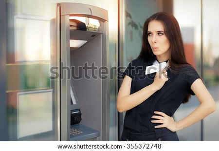 Surprised Businesswoman with Credit Card at ATM cash machine - Elegant business woman checking account balance   - stock photo