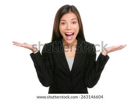 Surprised businesswoman with hands up amazed or shocked by unexpected news holding open palms up for copy space and showing happy expression. Asian mixed race young adult woman on white background. - stock photo