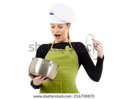 Surprised caucasian woman cook with a stainless steel pot, isolated on white background - stock photo