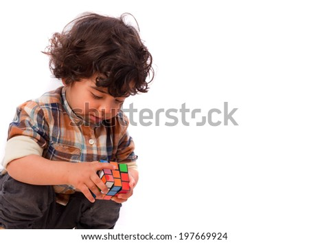 Surprised child solving a problem - stock photo