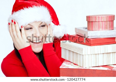 surprised christmas brunette woman with presents - stock photo