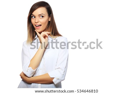 Surprised excited woman screaming amazed in joy. Beautiful young woman isolated on white background in casual white shirt. Asian Caucasian multiracial female model in her 18s