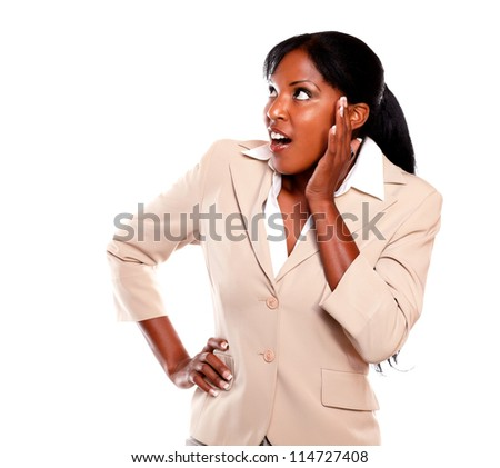 Surprised executive young female looking right against white background - stock photo