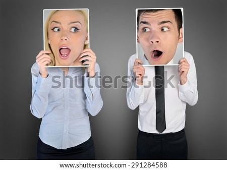 Surprised face of business woman and man - stock photo