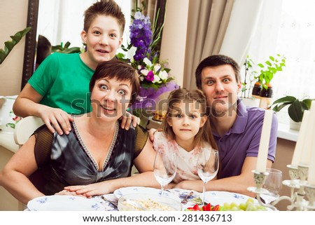 Surprised family looking at camera