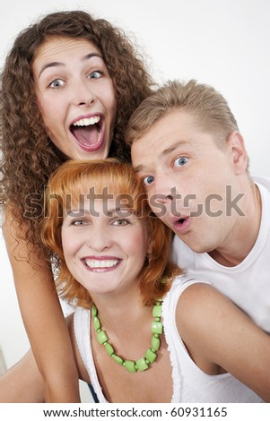 Surprised family, parents with their grown-up daughter. - stock photo