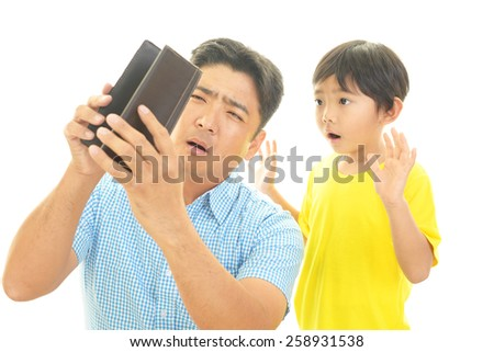 surprised father and son - stock photo