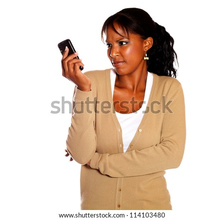 Surprised female reading a message on cellphone against white background - stock photo
