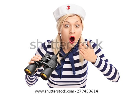 Surprised female sailor holding binoculars and looking at the camera isolated on white background - stock photo