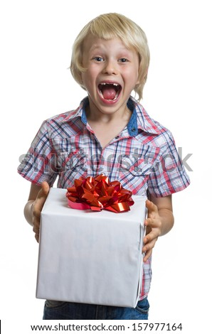 Surprised funny boy holding a wrapped gift with copy-space in his hands. Isolated on white. - stock photo