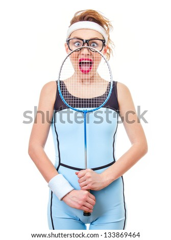 Surprised funny fit woman playing with recket over white background - stock photo