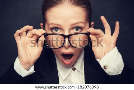 Surprised funny teacher in glasses shouts at the school board - stock photo