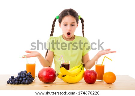 surprised girl chooses fruits and juices, isolated on white - stock photo