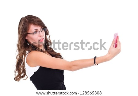 Surprised girl holding and looking to mobile phone - stock photo