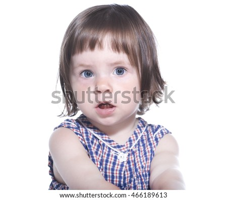Surprised girl in a checkered dress isolated on a white background