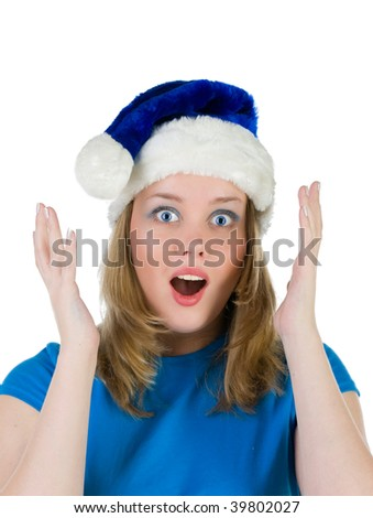 Surprised girl in blue christmas cap, isolated on white