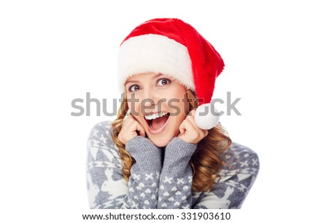 Surprised girl in Santa cap looking at camera