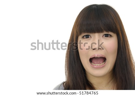 Surprised girl looking at copy space