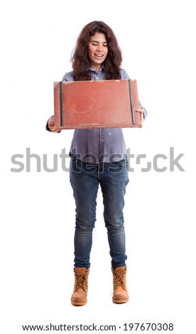 Surprised girl opening a leather wallet - stock photo