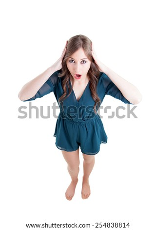 Surprised girl seen from above isolated on a white background - stock photo